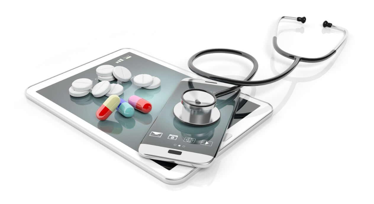 Stethoscope, pills and digital gadgets image
